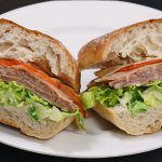 picture of deli sandwich with roast beef on ciabatta bun
