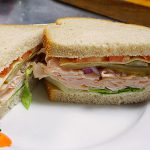 picture of deli sandwich with turkey on rye bread
