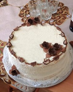 photo of a cake with chocolate flowers on top