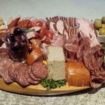 photo of cold cuts on wooden board