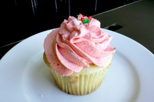 image of cupcake with strawberry cream on top