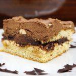 image of a cake made of chocolate vanilla, custard cream and chocolate bars