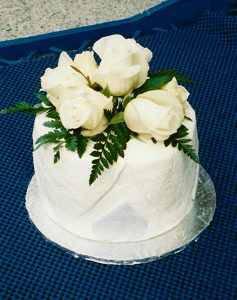 small cake with white roses on top