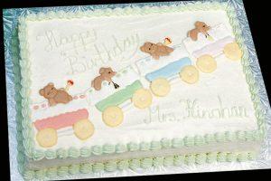 photo of a birthday cake with teddy bears