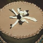 photo of a chocolate cake with marzipan roses