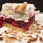 image of raspberry cake made with fresh raspberry, jell-o, whipped mascarpone and almond meringue