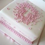 photo of a cake with small pink flowers