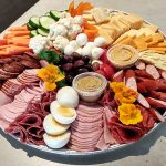 photo of charcuterie board with eggs and vegetables
